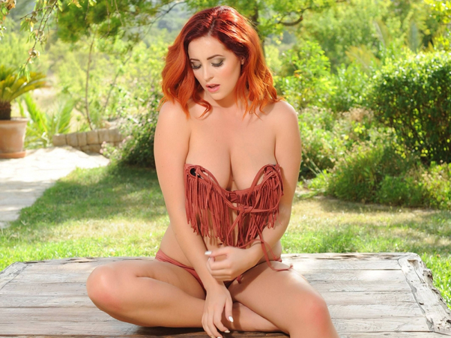 Lucy-Collett-Topless-in-a-Rose-Bikini-Garden-Photoshoot-05-cr1394141499812-900x675