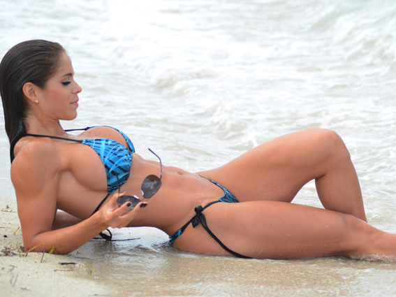 Melon-time at the beach for fitness star Michelle Lewin