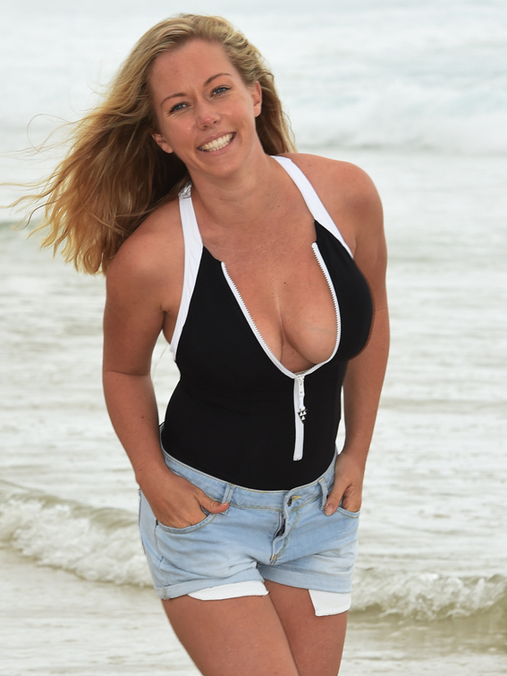 Kendra Wilkinson poses on a beach in Surfers Paradise