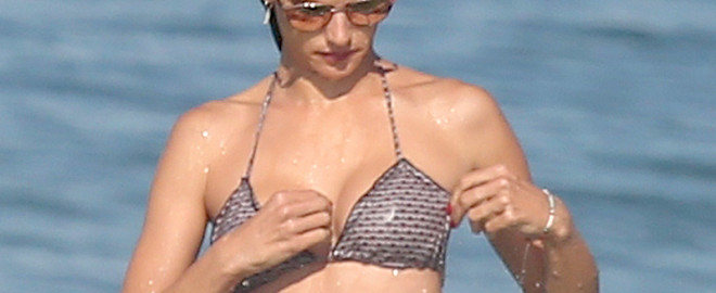 """*EXCLUSIVE* ** RESTRICTIONS: WORLDWIDE EXCEPT IN BRAZIL ** Rio de Janeiro, BRAZIL - *EXCLUSIVE* Rio de Janeiro, Brazil - Supermodel Alessandra Ambrosio hits the beach again to take a swim with her friends during her trip to Rio as a correspondent for the Olympic games.  Alessandra donned a sexy two piece bikini while sipping on coconuts with her friends and wore a cute trucker hat that read """"Squad"""" on it. *Shot on 08/02/16*    AKM-GSI 4 AUGUST 2016   To License These Photos, Please Contact :   Maria Buda  (917) 242-1505  mbuda@akmgsi.com  or    Mark Satter  (317) 691-9592  msatter@akmgsi.com  sales@akmgsi.com"""